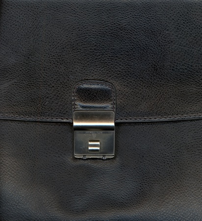 graining: Black leather background textured with graining patterns and lock