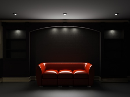 divan: Sof� de cuero rojo y librer�a en el cuarto oscuro Foto de archivo