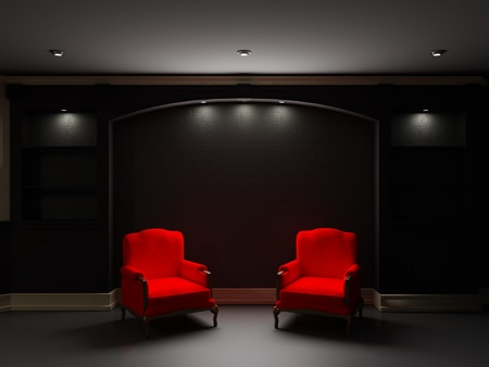 Two red chairs near bookcase in dark living room