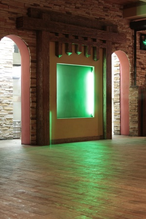 niche: Hall in cafe with green illuminated niche Editorial