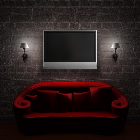 Red couch with LCD tv and sconces in minimalist interior photo