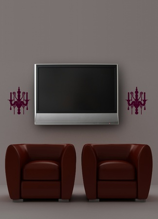 Two red armchairs with LCD tv and sconces on the wall photo