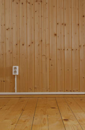Wooden interior with domestic power outlet  photo