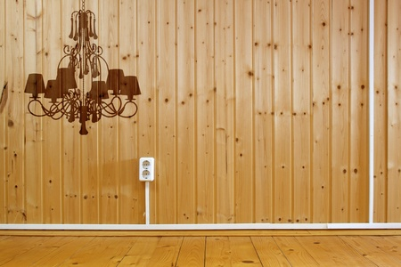 irradiate: Wooden interior with domestic power outlet and silhouette of luxury chandelier  Stock Photo