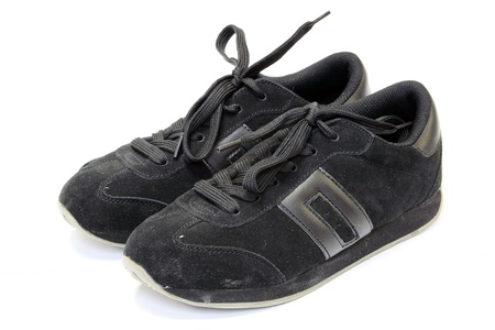 Black running shoes on a white background  photo