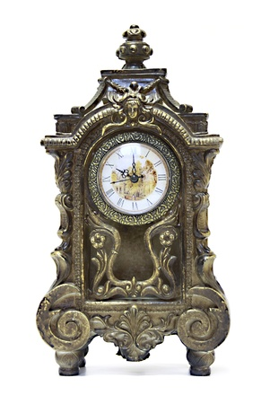 An antique clock ornate with floral motives photo