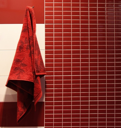 Red towel hangs in a bathroom  photo