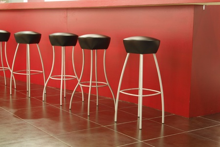 stool: Black stool in interior of bar on ceramic floor