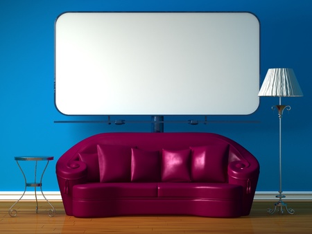 Purple couch, table and standard lamp with billboard beside photo