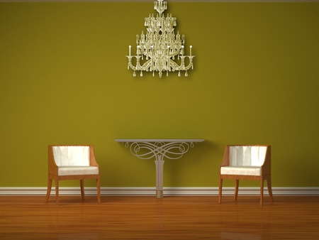 Two luxurious chairs with metallic console  in green interior photo