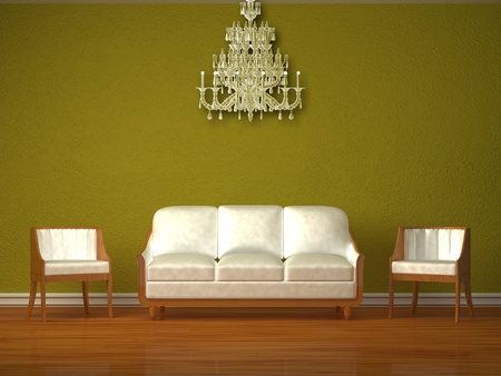 settee: White couch and two chairs in green interior