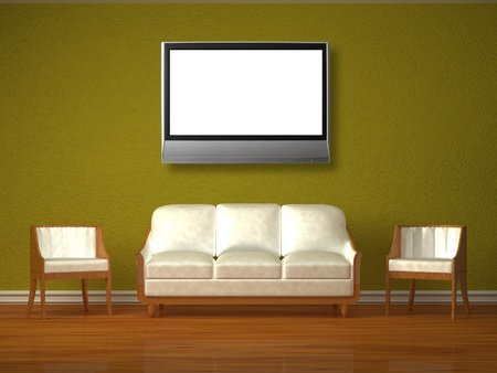 White couch and two chairs with lcd tv in green interior photo