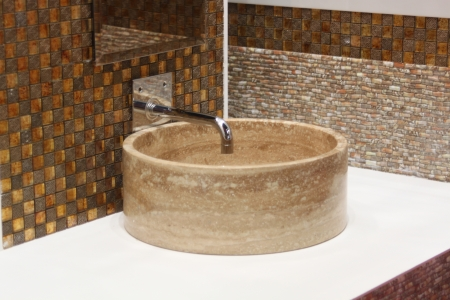 washbasin: Stone washbasin and chrome tap