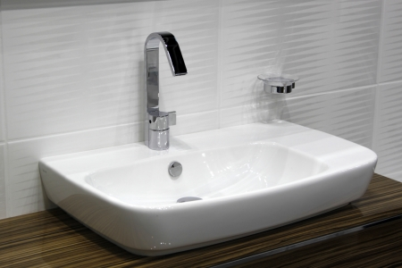 White and clean washbasin and chrome tap  photo