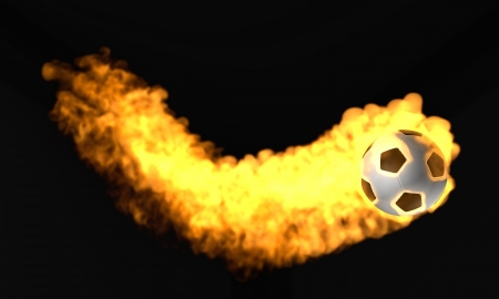 flaming flying  soccer ball on a black background photo
