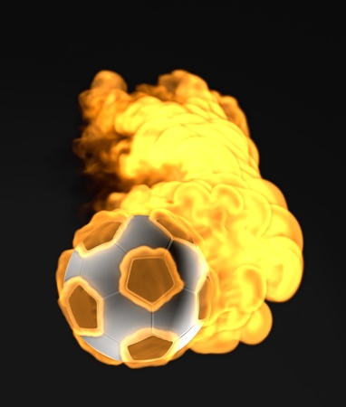flying soccer ball in the fire photo