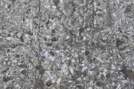 dissemination: texture of weathered gray concrete wall