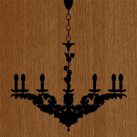 irradiate: luxury chandelier silhouette on the wooden background