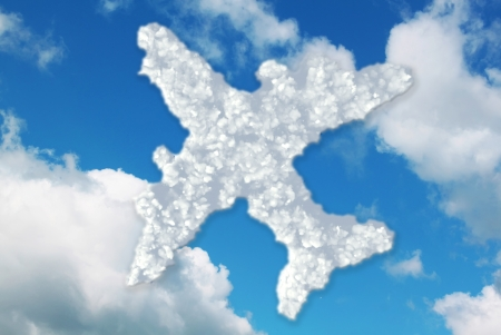 Clouds in shape of aeroplane icon on blue sky with white clouds photo