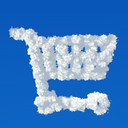 Clouds in shape of shopping cart icon on a blue  photo