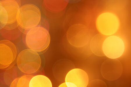 abstract blurred golden circular bokeh lights background photo
