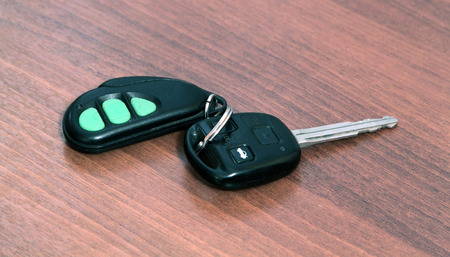 car key with remote on a wooden table photo