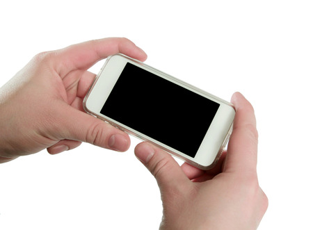 Man showing smart phone with isolated screen in hands photo