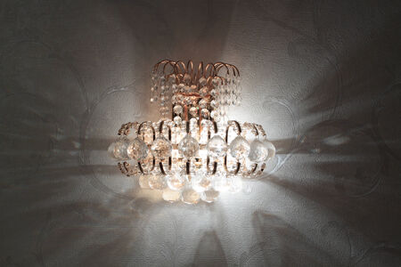 sconce: Close-up of a beautiful crystal sconce