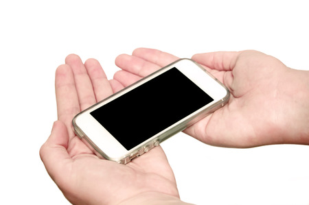Woman showing smart phone with isolated screen in hands photo