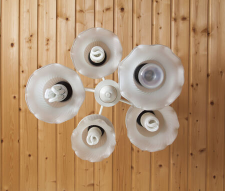 irradiate: Close-up of a white chandelier with eco bulb