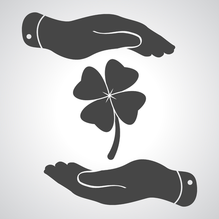 four hands: two hands protecting clover with four leaves sign icon. on a grey background. Saint Patrick symbol