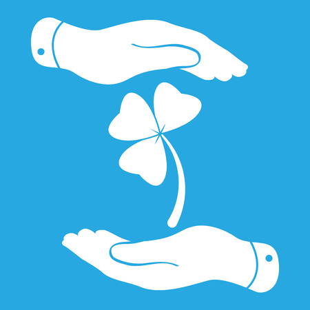 three hands: two hands with Clover with three leaves sign icon. on a blue background. Saint Patrick symbol