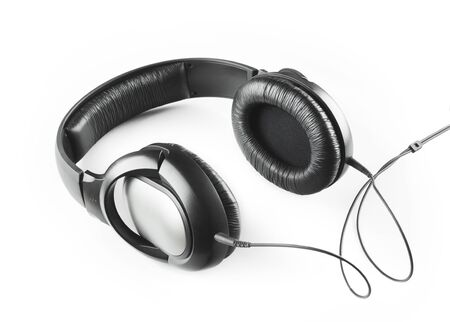 Music grey headphones with cable isolated on a white background