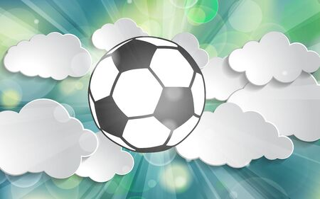 soccer ball in the rays of light of victory in the clouds