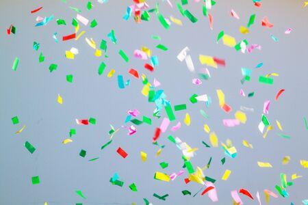 multi colored confetti on a grey background