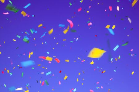 multicolored confetti on ultra violet background. Concept of holiday backdrop Stock Photo