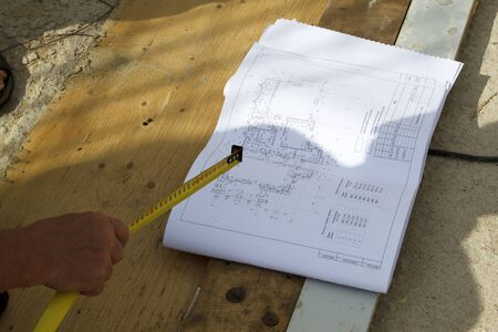 customer construction of a country house verifies the workflow with the project documentation
