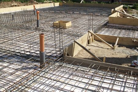 close up view of reinforcement of concrete with metal rods connected by wire. Preparation for pouring the Foundation Stockfoto