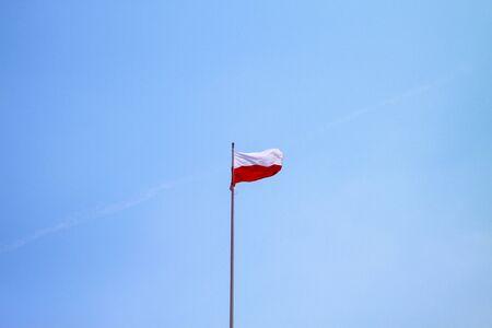 Poland flag on a blue sky background 版權商用圖片