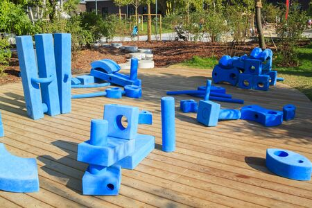 childrens playground in park with blue giant geometric figures for the development of imagination and spatial thinking Foto de archivo