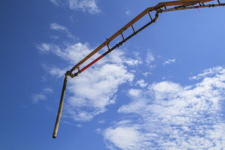 blue sky with white clouds and pipe of concrete pump