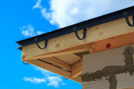 close up view of house under construction with holders for gutters water drainage system Zdjęcie Seryjne