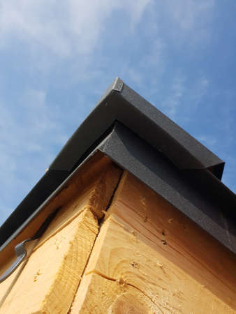 close up view of folded roof of house under construction with holders for gutters water drainage system 版權商用圖片