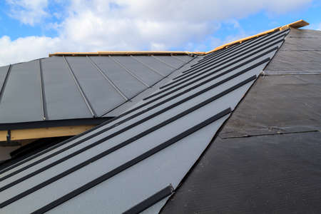 Close-up view of seam roof under construction on waterproofing layer