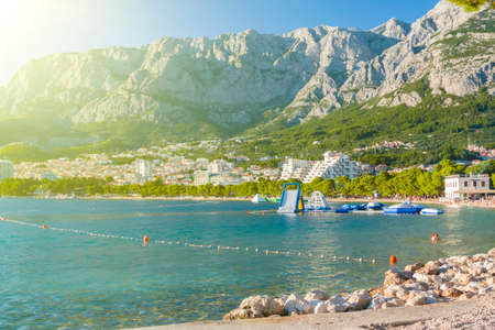 Panoramic view of Makarska coast architecture seascape with high mountains on background, Croatia Stock Photo