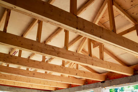 view of wooden rafters when installing roof on construction of house
