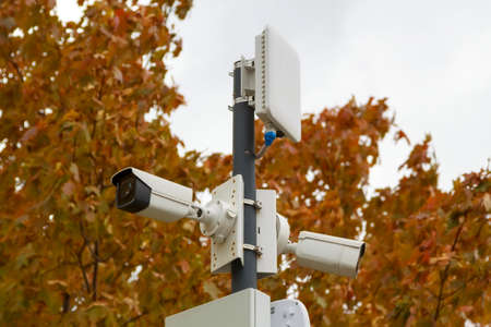 outdoor surveillance cameras and wireless access points in autumn city park
