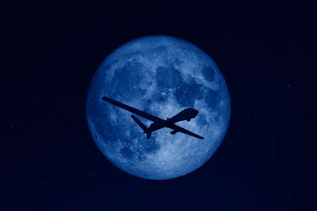 Silhouette of unmanned aerial vehicle (UAV) flying against background of huge full moon in dark starry space.