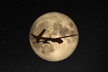 Silhouette of unmanned aerial vehicle (UAV) flying against background of huge full moon in dark starry space. Stock Photo