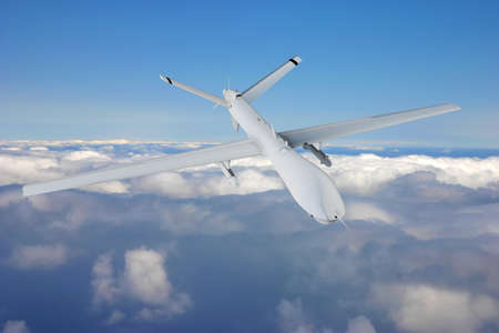 military RC military drone flies flies against backdrop of beautiful clouds on blue sky background.